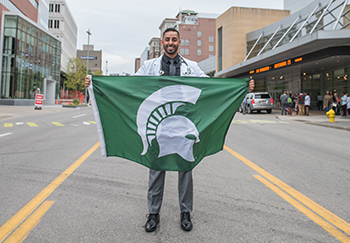 student with msu flag